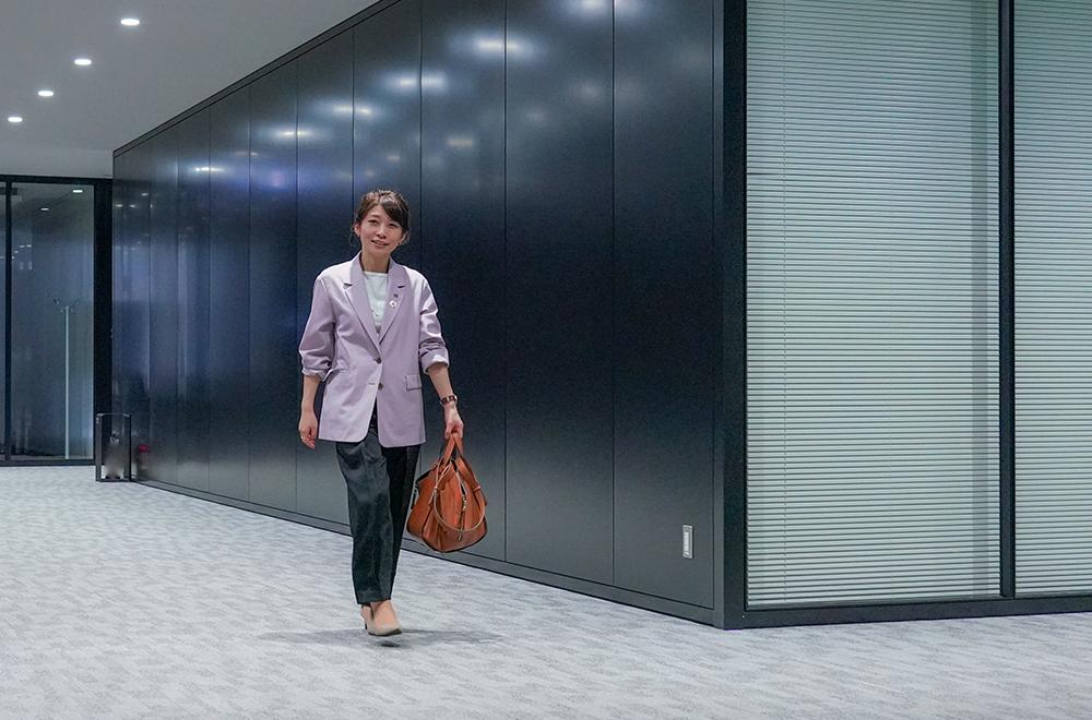 Picture of Kato walking office corridor