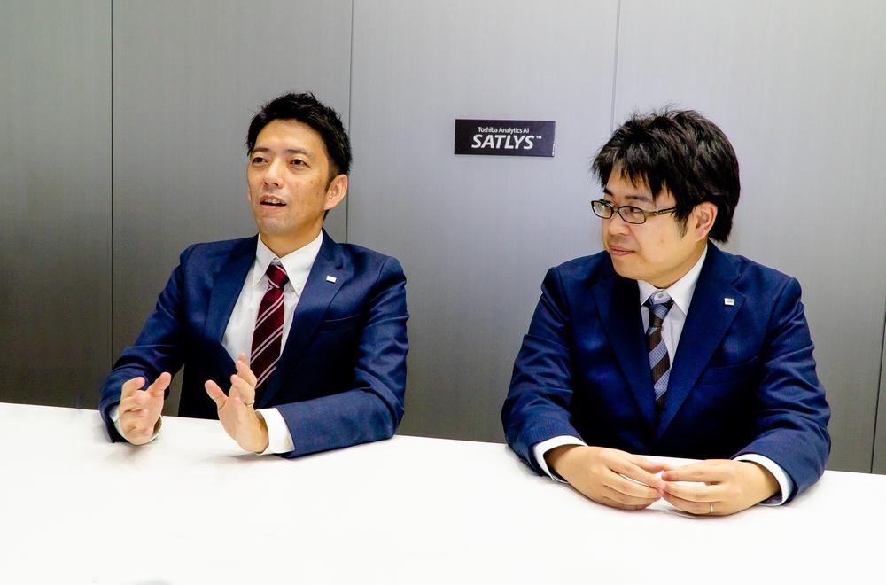 東芝デジタルソリューションズ株式会社 ソフトウェア&AIテクノロジーセンター 入本勇宇次氏(左)と、同じく今回の実証実験に携わる、同・上田弘樹氏(右)